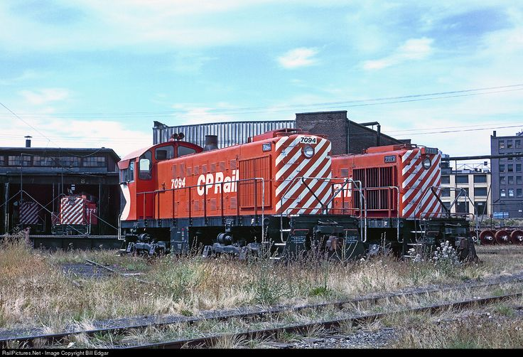 A group of MLW/Alco switchers including S2 7094 rest between assignments in downtown Vancouver, BC in August 1978. The foreground track was used to turn the Canadian passenger train consist after arrival and unloading at the CP station across town. This yard serviced industries and handled servicing of CP's passenger trains and locos until the property was re-purposed for Expo 86. By that time the Canadian was operated by VIA using the CN station.