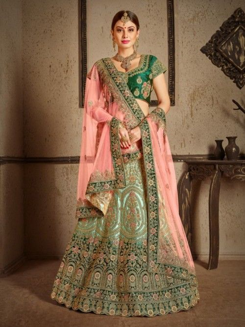 287be446ee8 Exotic green partywear lehenga choli online for women which is crafted from  satin fabric with exclusive zari