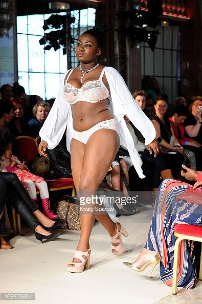 A model walks the runway for Women Curves during the Third Pulp Fashion Week at Salon Hoche on April 11, 2015 in Paris, France.