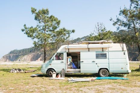 Their home has six wheels and surfboards on the roof!