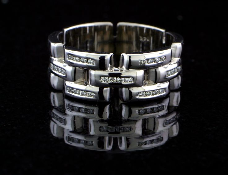 Mens custom fabricated wedding band in 14k white gold with link style band. Diamonds are channel set in each link
