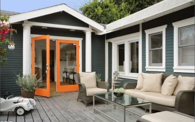 The exterior colors of our next house... loving the orange door!