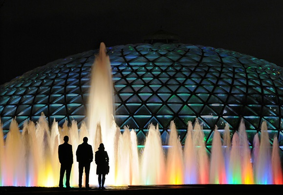 "Passersby enjoy the ""Dancing Waters"" fountain outside of the Bloedel Conservatory at Queen Elizabeth Park."