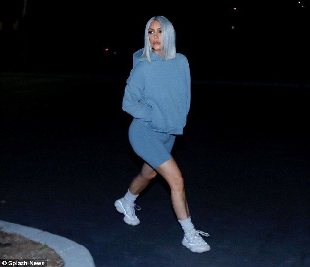 Working mom: Kim Kardashian left a meeting in Calabasas, California, on Tuesday night after revealing her son Saint, two, was 'all better' after a 'scary' few days in hospital