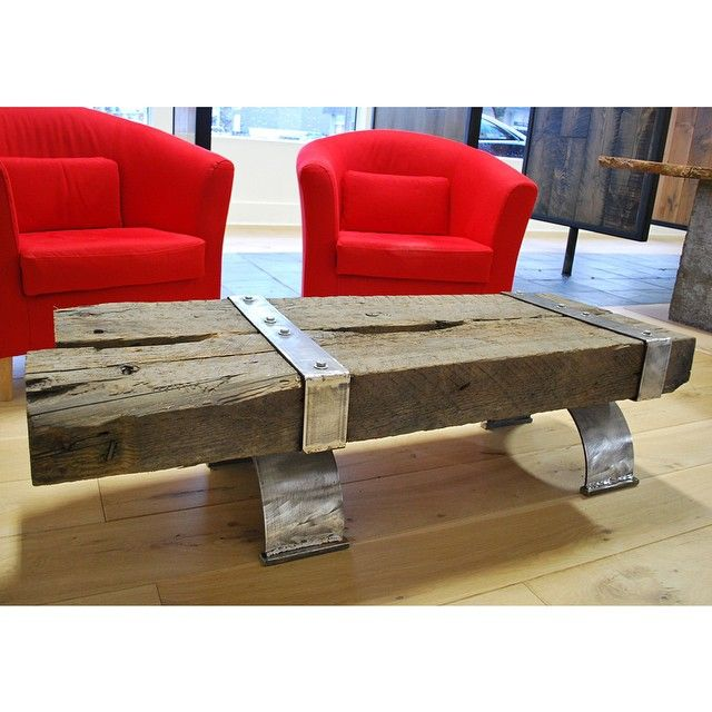 Reclaimed coffee table made from old railway trestle pieces & in-house custom metalwork || #custom #reclaimed #timber #wood #sustainable #ecofriendly #design || Copyright © 2015 Canadian Heritage Timber Company || http://www.canadianheritagetimber.com/