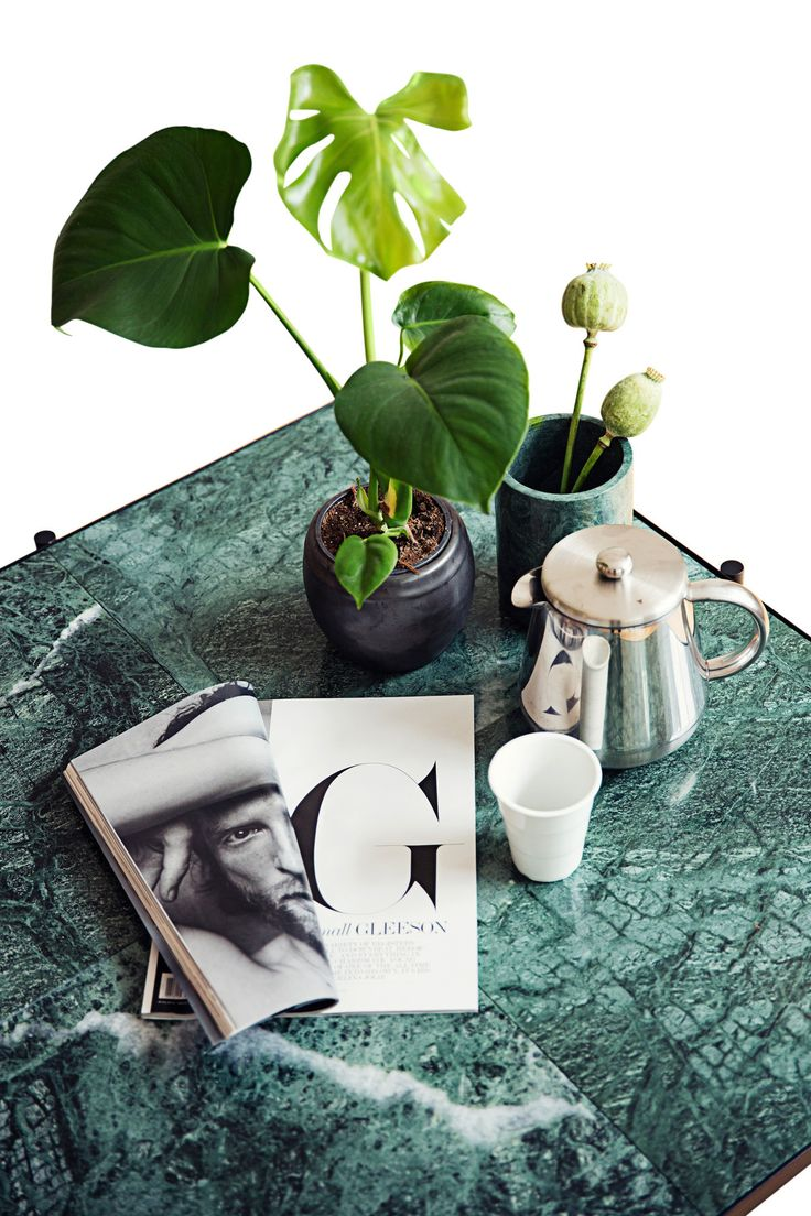 The HANDVÄRK Coffee Table 90. The result is a generously proportioned, low coffee table. The expression is streamlined and contemporary, largely characterized by the fragments of nature: marble that has been quarried into 4 pieces - making this table a modern version of the tile top table.