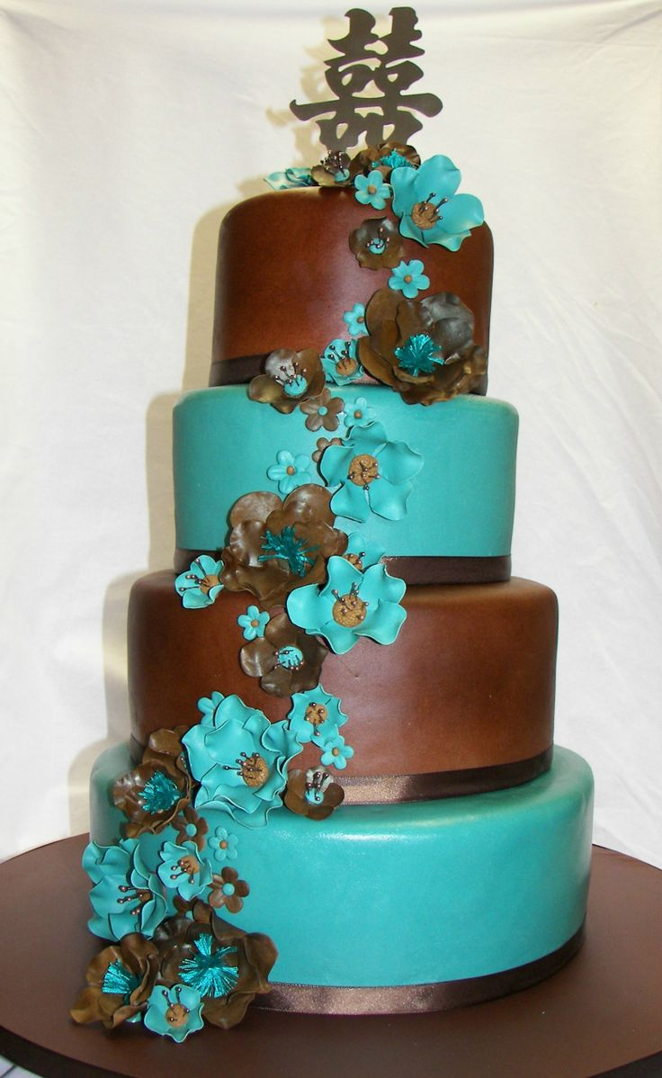 jade and brown wedding cake - all fondant, ribbon borders and fantasy flowers. I used embroidery floss for the centers of the large brown flowers.  The brown flowers were airbrushed before the centers were put in.