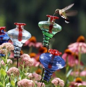 Hummingbird garden stakes. What an awesome idea! I have to try this in my own hummer garden
