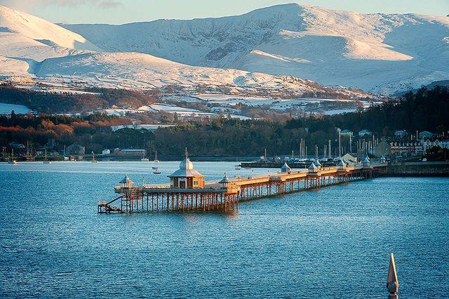 Pier Bangor Snow on mountains in distance Menai Strait Photo © Crown copyright (2012) Visit Wales   North Wales