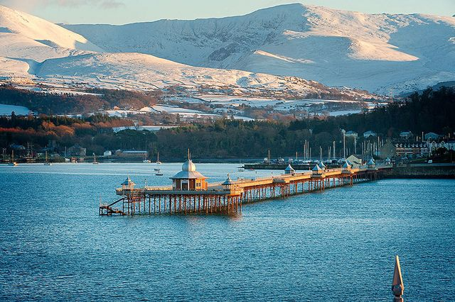 Pier Bangor Snow on mountains in distance Menai Strait Photo © Crown copyright (2012) Visit Wales | North Wales