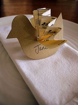 DIY Love Birds Wedding Theme Ideas |  {DIY Tip} Stencil a bird shape on sturdy card and cut out. Create a slit near the tail of the bird where a pleated sheet of music can be inserted.