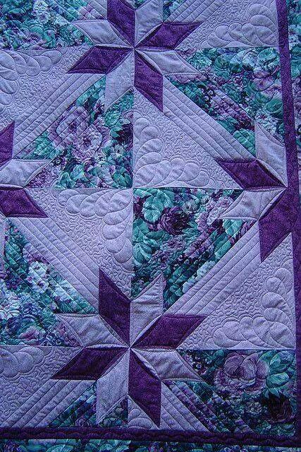 Quilt: aqua, purples on lilac.