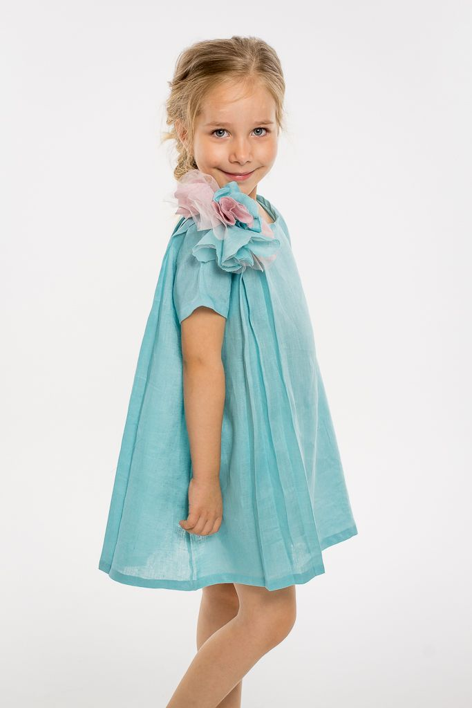 By far the most wanted dress from this collection. Linen dress in sumer colors and with a beautiful hand made flower application. With love, from Designers for kids