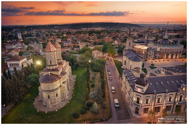 """Above all - Top view over old architecture in city of Iasi, Romania. The place where religions are intertwined. In the left the """"Trei Ierarhi"""" orthodox monastery and in the left the Greek Catholic cathedral in city of Iasi, Romania."""