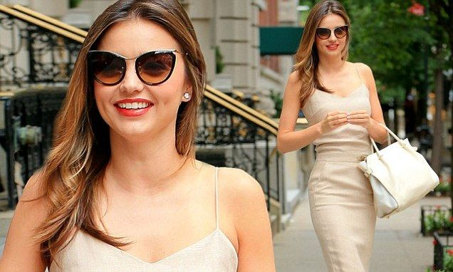 Miranda Kerr is the height of chic in fitted beige frock