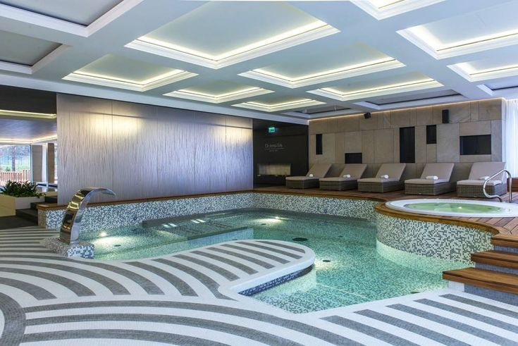 """This contemporary indoor pool and spa has a custom 3/4""""x3/4"""" recycled glass tile. There are premade mixes or you can create your own. Great for pools, jacuzzis, kitchen and bathrooms."""