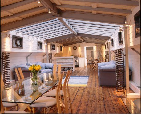 Converted 1930's Dutch barge. Roderick James Architects LLP.  idea for our living room ceiling..paint the existing  board dark brown and put beautiful wood beam the other way?