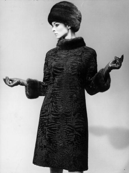 A winter outfit designed by Pierre Balmain, consisting of a coat of astrakhan breitschwantz and matching dark mink hat, 1966