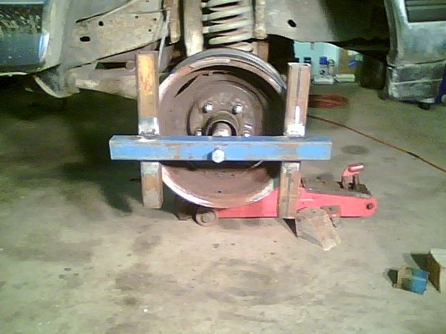 homemade wheel bearing puller. homemade wheel puller intended to facilitate the removal of stuck bearings from spindles. tool was constructed a surplus rim, box tubing, bearing i