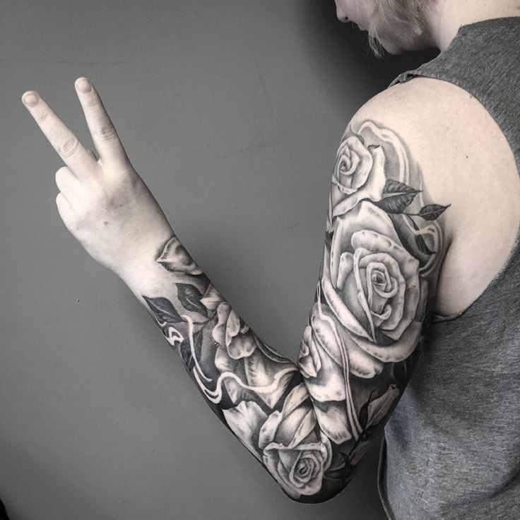 Black and grey realistic rose sleeve by Whitney Thompson from Human Kanvas Calgary