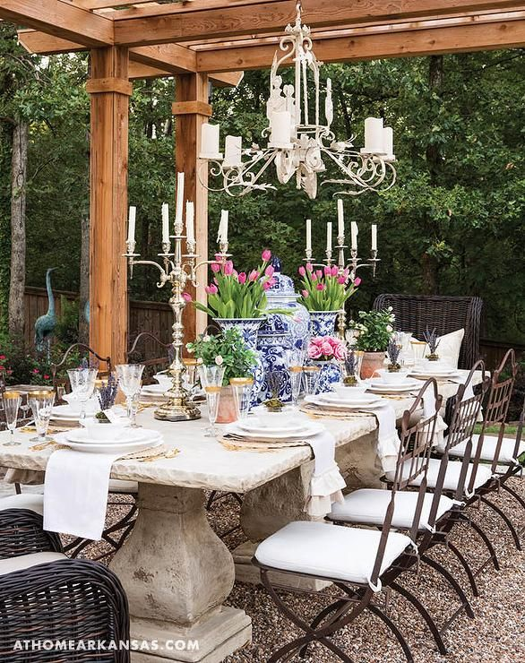 Awesome Whimsical Garden Features A French Style Concrete Dining Table Seating  Eight Wrought Iron Dining Chairs With