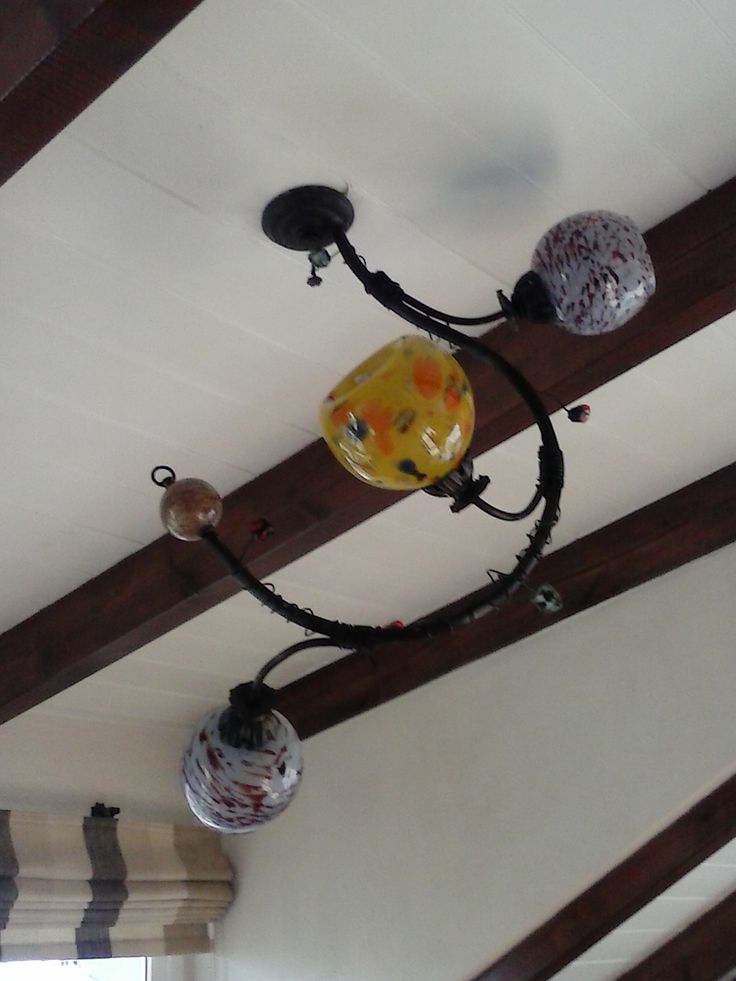 Hanging bronze chandelier with blown glass