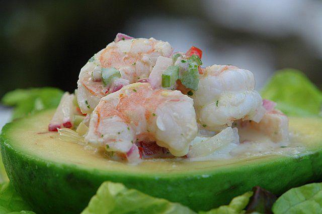 Delicious recipe for shrimp stuffed avocado made with ripe avocado filled with shrimp, red onion, radish, bell pepper, celery and cilantro aioli salad.