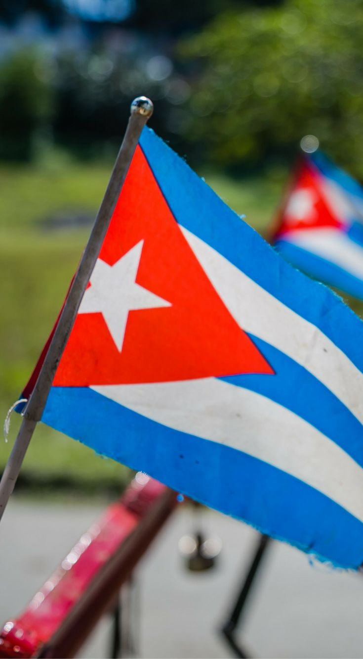 Cuban flags sitting on a bike in Las Terraza, Cuba. The photo was taken By Lina Stock on the Divergent Travelers Photography Tour in Cuba. The Divergent Travelers Adventure Travel blog showcases great stories and some of the best travel photography in the