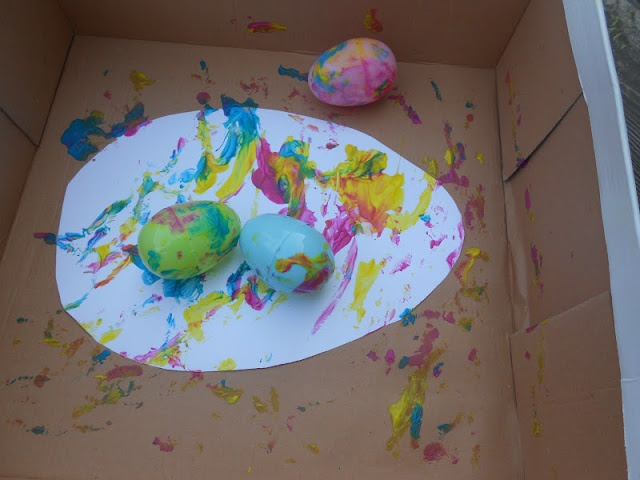 Roly Poly Egg Painting - Toddler Approved!: Jan Brett Inspired Easter Egg Crafts & Activities
