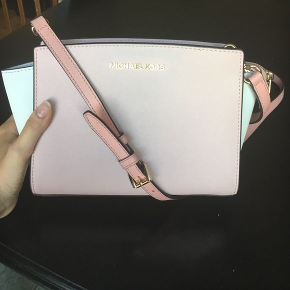 "Michael Kors Selma colorblock crossbody Pink and white with gold hardware. Back of bag has slight blue tint from rubbing on jeans (pictured) and bottom is slightly dirty (pictured). Bag measures approx 6.75""H x 10.5""W x 4""D. Top zip closure. One small zip closure inside pocket. Michael Kors Bags Crossbody Bags"