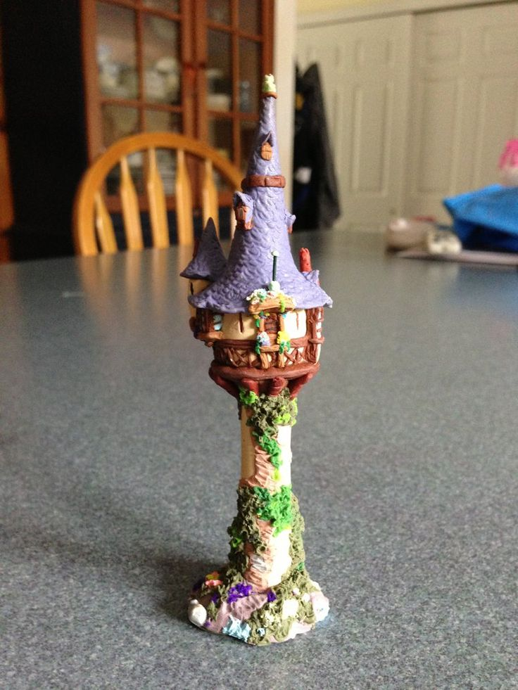 Polymer clay miniature of Rapunzel's tower from Disney's Tangled It is about 4 inches in height and took a few hours to make.