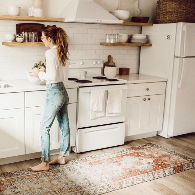 Tribal rug in kitchen with open wood shelving