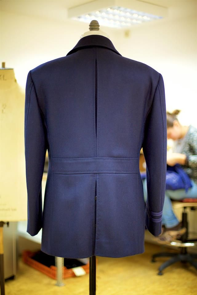 The back of our Naval Pea Coat features an 'action back' in the upper section and, below the belt, a buttoned double-vent.