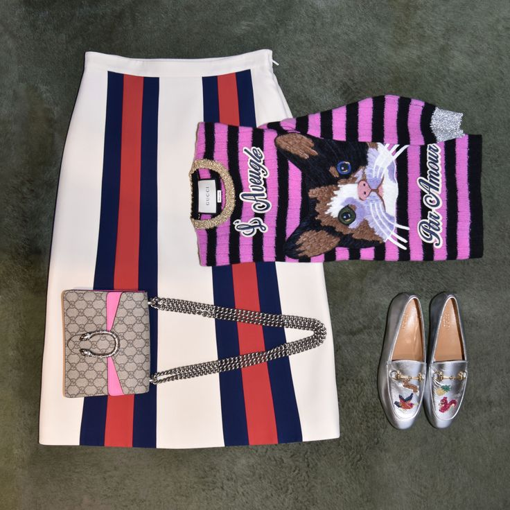 GUCCI MOOD:  cat embroidered knit top  Wool skirt with web Dionysus GG Supreme shoulder bag  metallic leather loafers
