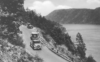 Malahat Drive, constructed in 1910 (cost, $200,000) permitted cars to reach the Cowichan Valley from Victoria. Here, the road had been recently upgraded with pavement and railings to ease travel by car.