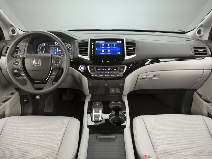 The 2016 Honda Pilot's interior is a big upgrade over the previous generation, as it ditches the dash mounted shifter for a more modern push-button variant amongst other upgrades.