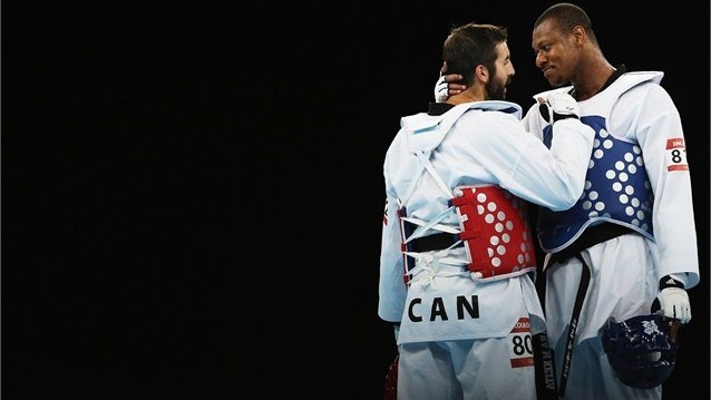 Francois Coulombe-Fortier of Canada hugs Daba Modibo Keita of Mali following the quarter-final on Day 15.