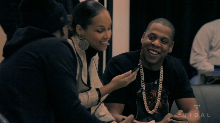 "A proud Jay Z, captured showing Alicia Keys and Nas pictures of a one-month-old Blue Ivy Carter on his mobile phone, as seen in the TIDAL-exclusive visual for ""Glory""—his January 9, 2012-released dedication to his newborn daughter. The melodic track..."