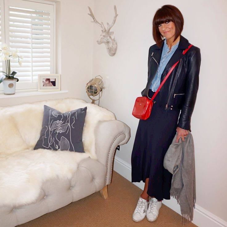 Navy leather biker jacket styled with a ruffled collared denim blouse, red cross body bag, navy maxi skirt, white trainers and an oversized wool scarf.#ootd #wiw #lotd #over40 #over40fashion #fashion #howtodresswhenyoureover40 #over40style #midlife #whattowear #howtostyle #style #stylingtips #leatherjacket #bikerjacket #maxiskirt #trainer #denimshirt #denimblouse
