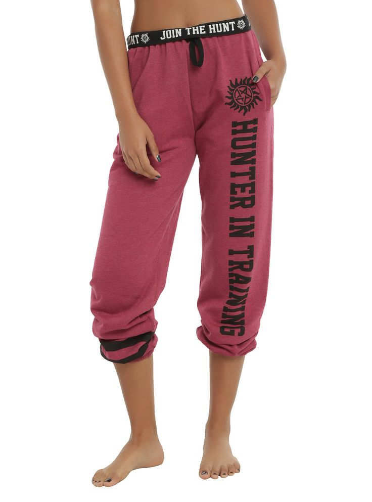 "For all you hunters in training, these <i>Supernatural</i> relaxed jogger pants will help you get on the Winchester's level.<br><br>Burgundy heather oversized jogger pants with a ""Hunter In Training"" design on the left leg, black stripes on the right leg and ""Join The Hunt"" on the fold-over elastic waistband. Features hip pockets and drawstring waist.<br><ul><li style=""LIST-STYLE-POSITION: outside !important; LIST-STYLE-TYPE: disc !important"">60% cotton; 40% polyester</li><li…"