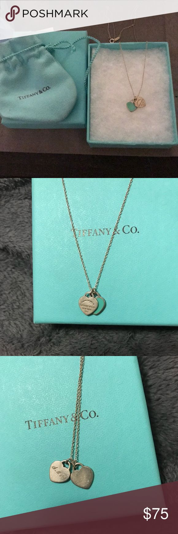 Tiffany heart necklace Good condition barley worn. Has SMB initials engraved on back of blue heart. Tiffany & Co. Jewelry Necklaces