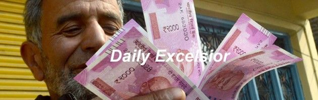 People counting newly received Notes after exchanging the old demonetised Notes.Excelsior\Shakeel-ul-Rehman