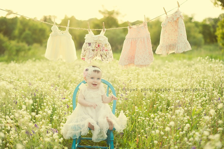 1 year photoshoot! The dresses on the clothes line are clothes from her newborn, 3 month, 6 month & 9 month shoots!