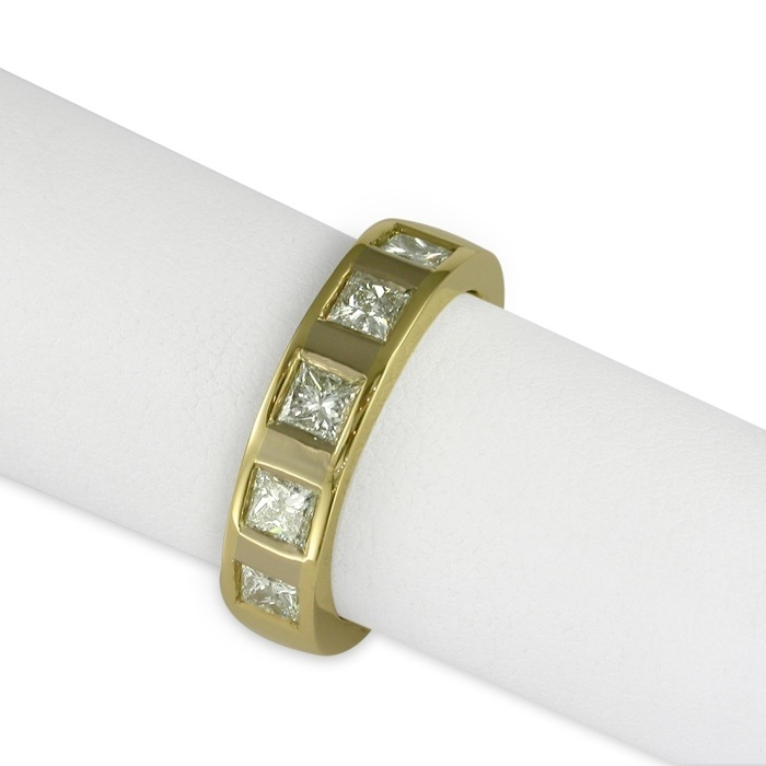 Jens Hansen  An 18ct Gold band, set with five 3mm square cut diamonds, and featuring 18ct White Gold.  Approx price $5499