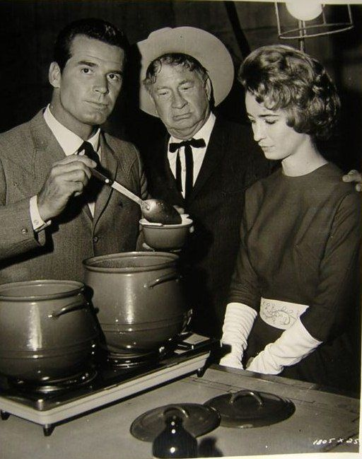 James Garner - maybe with chili?!  Jim Loves his food. But in this publicity shot for THE WHEELER DEALERS, we're not sure why he is disapproving of the meal. Chill Wills (Francis, The Talking Mule) is in the shot as well.