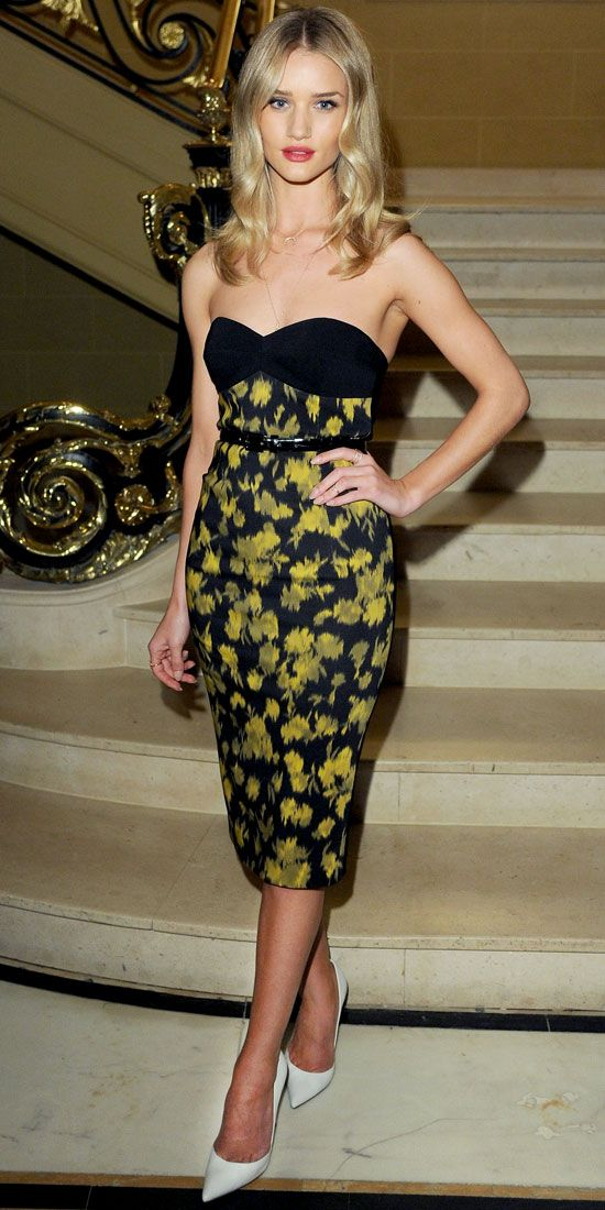 04/26/13: At a dinner in London celebrating Michael Kors, Rosie Huntington-Whiteley wore a black and chartreuse leaf-print dress by the designer. #lookoftheday