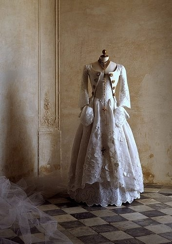 18th century gown. (Never mind the gown, look at that gorgeous interior)