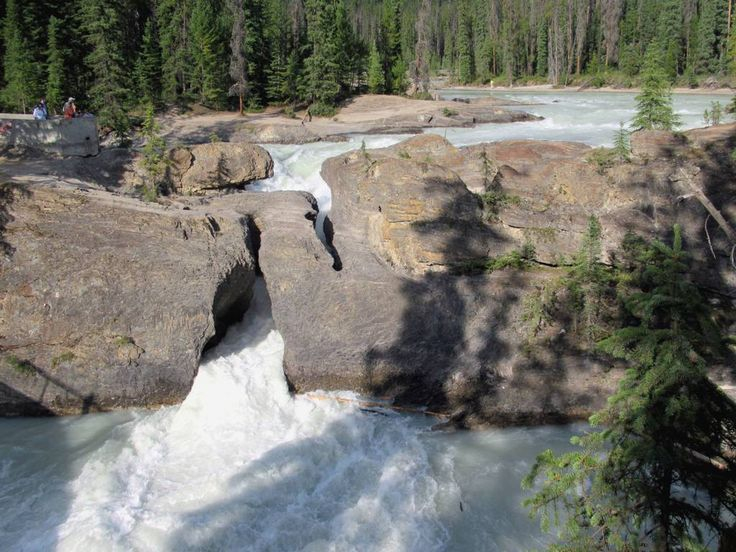 The Natural Bridge on the Kicking Horse River is a highlight of Yoho National Park, British Columbia, Canada.
