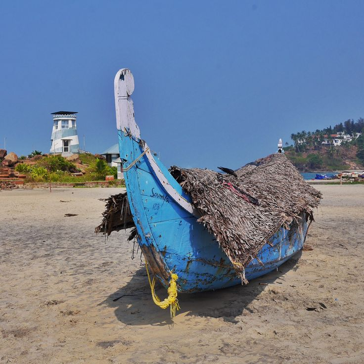 Brightly painted boats on the beaches of Kovalam, Kerala thesweetwanderlust.com