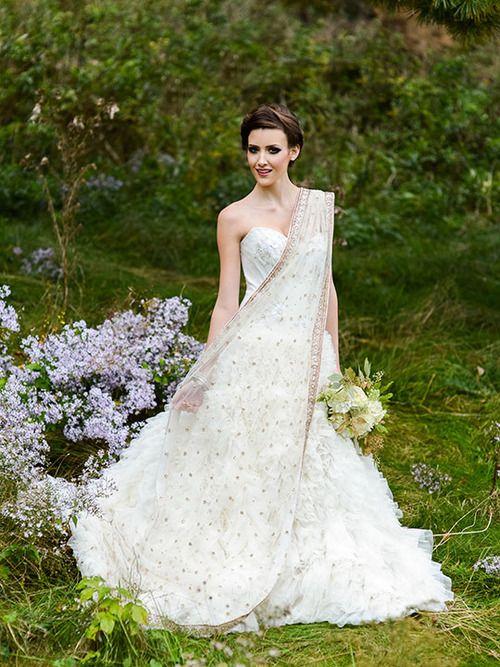 Wedding gown with Indian dupatta veil Photo byErwin Loewen  Jewelled Wedding Gowns